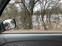 The Cosumnes River and Deer Creek overflowing banks in some area. View from Wilton Road.